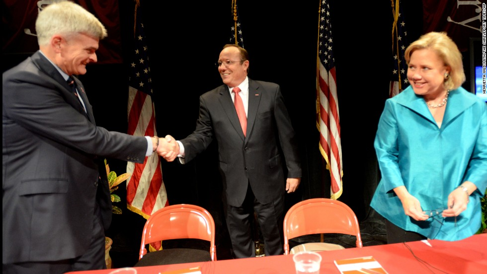 Cassidy shakes hands with Maness before the three candidates debate one another October 14 at Centenary College in Shreveport, Louisiana.