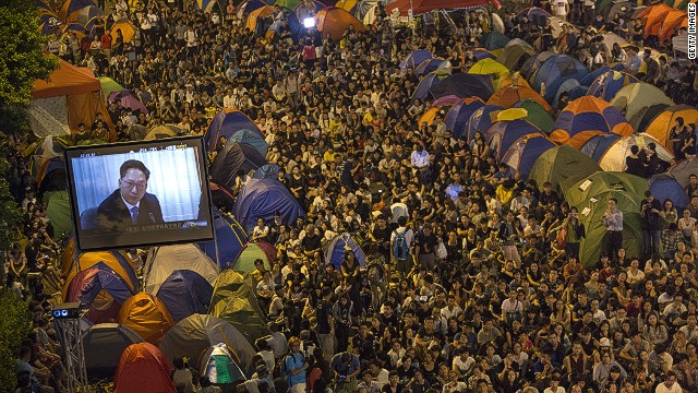 HONG KONG - OCTOBER 21: Tens of thousands of protesters gathered to listen to the talks between the government officials and the protesters tonight at the main protest site on October 21, 2014 in Hong Kong, Hong Kong. The talks were a small step towards compromise between the two sides as the protest reaches its fourth week. (Photo by Paula Bronstein/Getty Images)