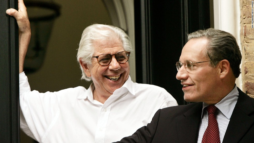 "Bernstein, left, and Woodward speak to reporters in June 2005, after the identity of their Watergate scandal source ""Deep Throat"" was confirmed to be former FBI official Mark Felt."