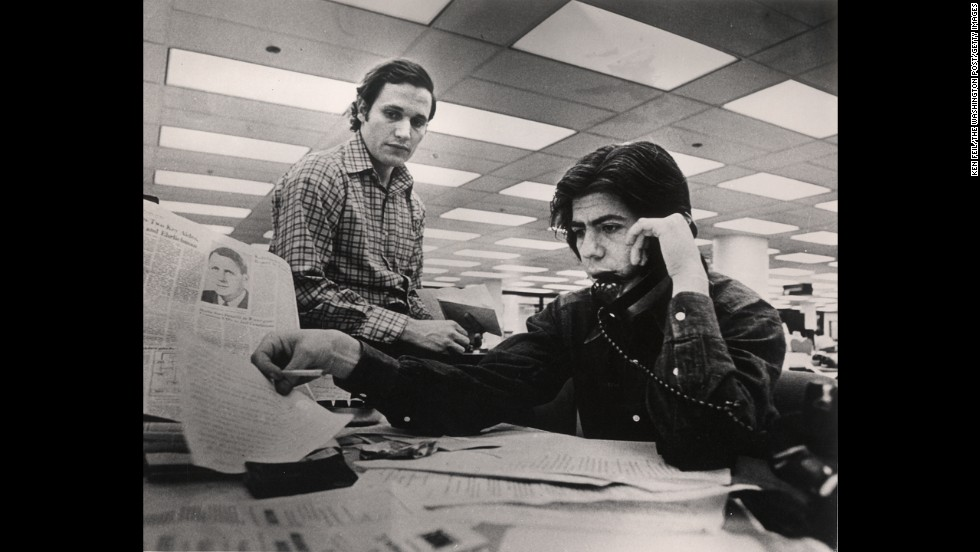 In April 1973, Woodward, left, and Bernstein work the Watergate story from the Washington Post newsroom.