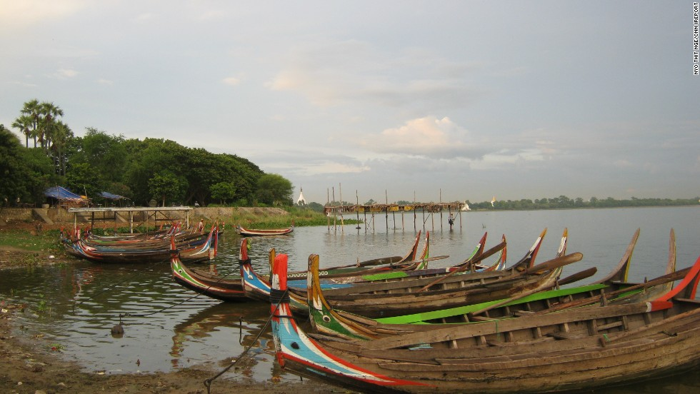 "Colorful boats dock along the banks of <a href=""http://ireport.cnn.com/docs/DOC-878952"">Taungthaman Lake</a> near Amarapura, Myanmar. Locals from nearby villages use these boats to commute to work daily."