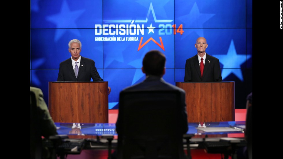 "The candidates' second televised debate was overshadowed by ""Fangate,"" when Scott refused to go on stage for seven minutes after he discovered Crist had a fan under his podium."