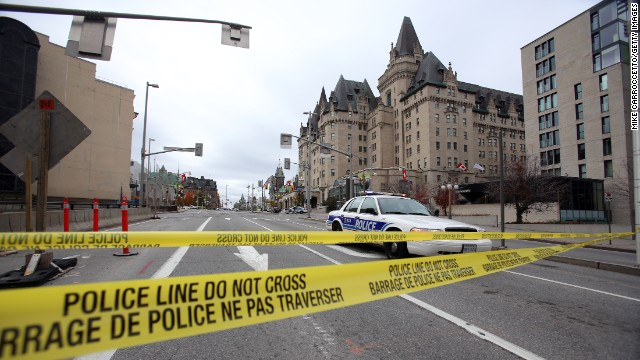 Caption:OTTAWA, CANADA - OCTOBER 22: Police tape blocks Wellington St. at Sussex near the National War Memorial where a soldier was shot earlier in the day, just blocks away from Parliament Hill, on October 22, 2014 in Ottawa, Canada. Officials are investigating multiple reports of shootings and suspects after at least one gunman shot a Canadian soldier and then entered Canada's Parliament building. (Photo by Mike Carroccetto/Getty Images)