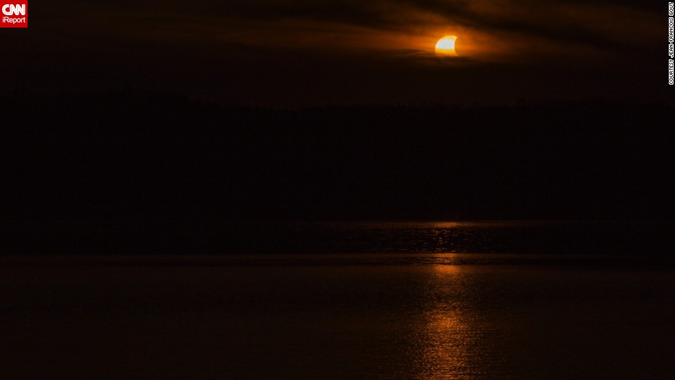 "Thursday's event was Jean-Francois Gout's fifth solar eclipse. He spent so long driving to find a spot to photograph it that he wound up in the next state. He shot this photo from <a href=""http://ireport.cnn.com/docs/DOC-1182676"">Lake Logan</a> in Ohio."