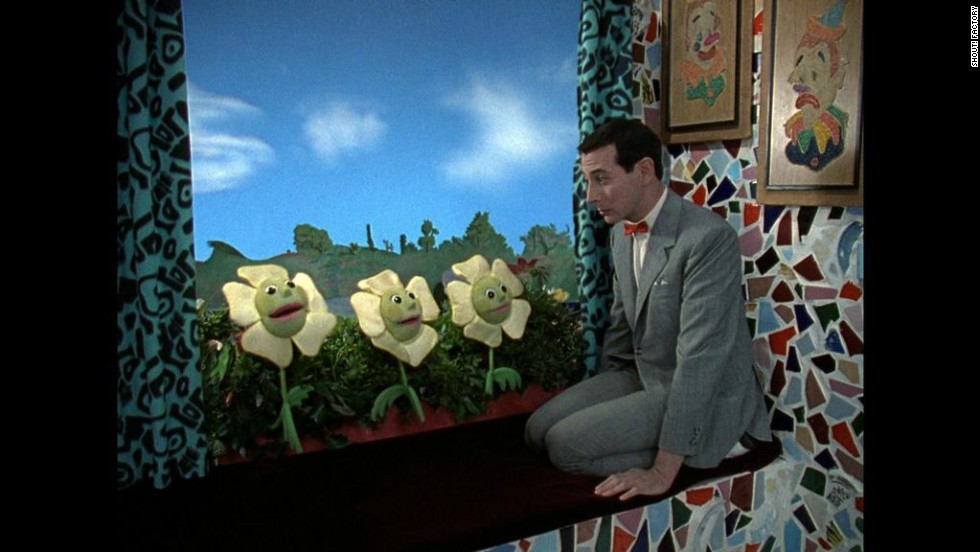 Pee-wee and the window box flowers have a heart-to-heart-to-heart-to-heart.