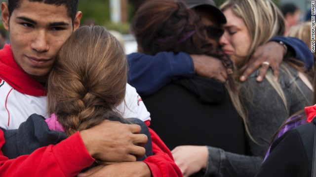 Caption:MARYSVILLE, WA - OCTOBER 24: Students and family members embrace after leaving Marysville-Pilchuck High School in the aftermath of a shooting on the high school's campus on October 24, 2014 in Marysville, Washington. At least two are dead, including the shooter, according to authorities, with several more wounded. (Photo by David Ryder/Getty Images)