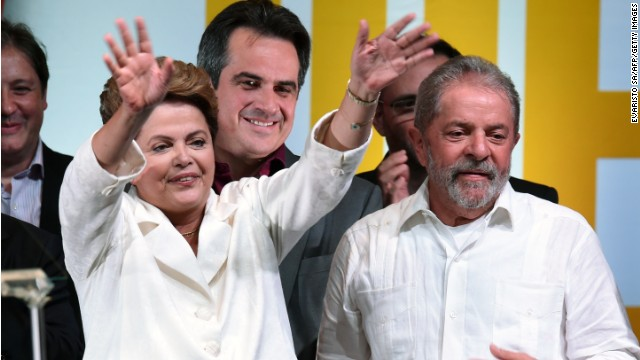 Re-elected Brazilian President Dilma Rousseff (L) waves next to former Brazilian President Luiz Inacio Lula Da Silva, following her win, in Brasilia on October 26, 2014. Leftist incumbent Dilma Rousseff was re-elected president of Brazil, the country's Supreme Electoral Tribunal said, after a down-to-the-wire race against center-right challenger Aecio Neves. Rousseff, who had 51.45 percent of the vote with 98 percent of ballots counted, was declared the run-off winner. AFP PHOTO / EVARISTO SA (Photo credit should read EVARISTO SA/AFP/Getty Images)