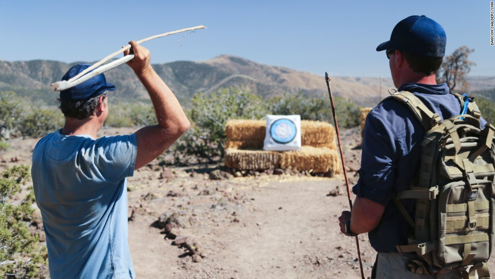 Rowe visited a survival school, where Thomas Coyne gave him a spear-throwing lesson.