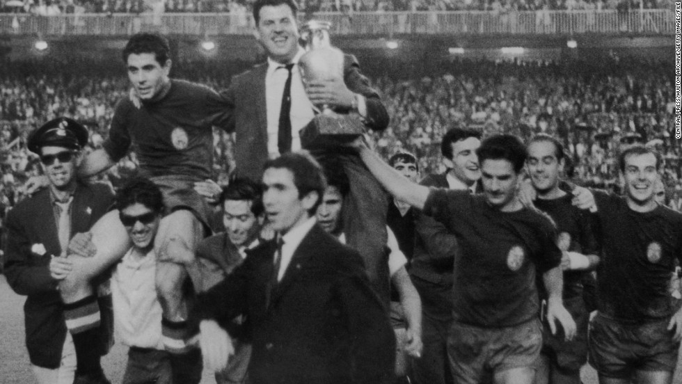 The Spanish football team bear their manager, Jose Villalonga, aloft to celebrate their victory in the 1964 European Nations Cup, when they beat the Soviet Union 2-1 at the Santiago Bernabeu.