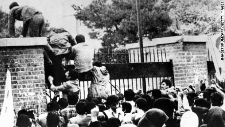 Iranian students climb over the wall of the U.S. embassy in Tehran on November 4, 1979.