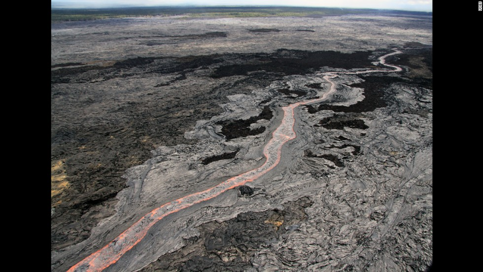 A view of the sinuous, channelized flow that was moving to the northeast from Kilauea on June 27. The flow threatening Pahoa has advanced about 13 miles (21 kilometers) since then. Kilauea is one of the world's most active volcanoes.