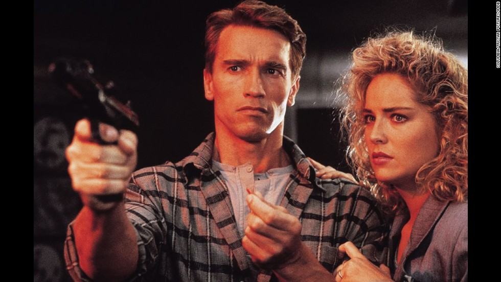 "Schwarzenegger (here with Sharon Stone) also stars in 1990's ""Total Recall,"" which takes place in 2084. His character is apparently implanted with memories and makes his way to Mars. A shootout in a subway station features both a bit of high-tech gadgetry and director Paul Verhoeven's love of graphic violence."