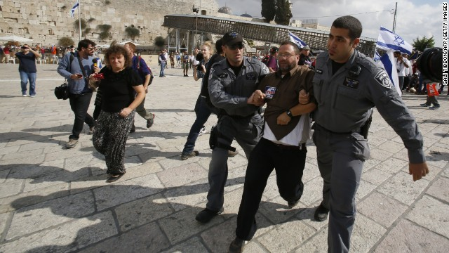 "Israeli police detain right-wing activist Noam Federman after he tried to enter the Temple Mount the most sacred spot for Jews because it once housed two Jewish temples,  also know as the Al-Aqsa mosque compound, Islam's third holiest site in the old city of Jerusalem, on October 30, 2014 after Israeli authorities temporarily closed the compound. Israel's closure of the flashpoint Al-Aqsa mosque compound to all visitors following the shooting of a Jewish hardliner is tantamount to a ""declaration of war,"" Palestinian president Mahmud Abbas said today. AFP PHOTO/ GALI TIBBON        (Photo credit should read GALI TIBBON/AFP/Getty Images)"