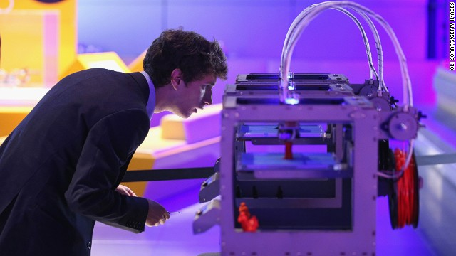 A technician checks on a 3D printer as it constructs a model human figure in the exhibition '3D: printing the future' in the Science Museum on October 8, 2013 in London, England.
