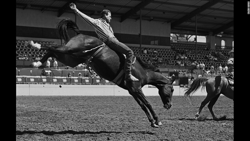 A bareback bronco rider displays perfect form at a gay rodeo event in San Diego in 1990. Photographer Blake Little became fascinated with the gay rodeo circuit in the 1980s, and he even competed and won Bull Riding Champion of the Year in 1990.