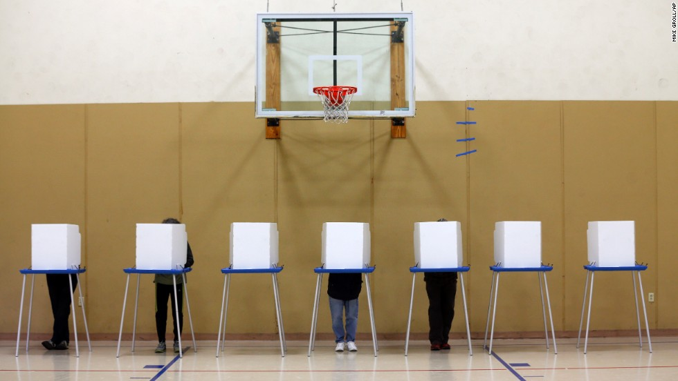 People vote in a gym at the St. Sophia Greek Orthodox Church in Albany, New York.