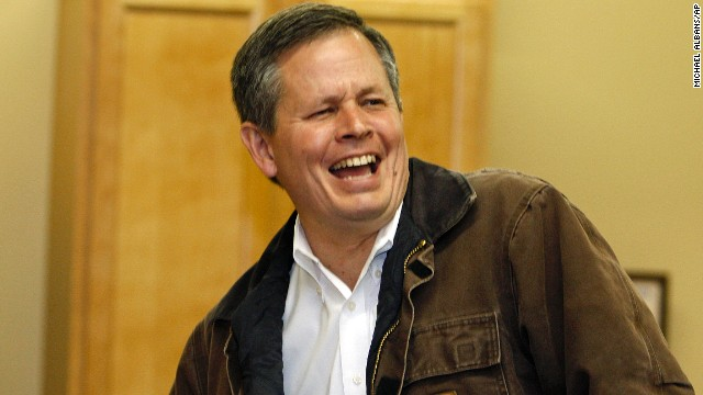 Montana Republican Senate candidate Rep. Steve Daines laughs with volunteers inside his election headquarters in Bozeman, Mont., Tuesday, November 4, 2014.(AP Photos/Michael Albans/AP.)