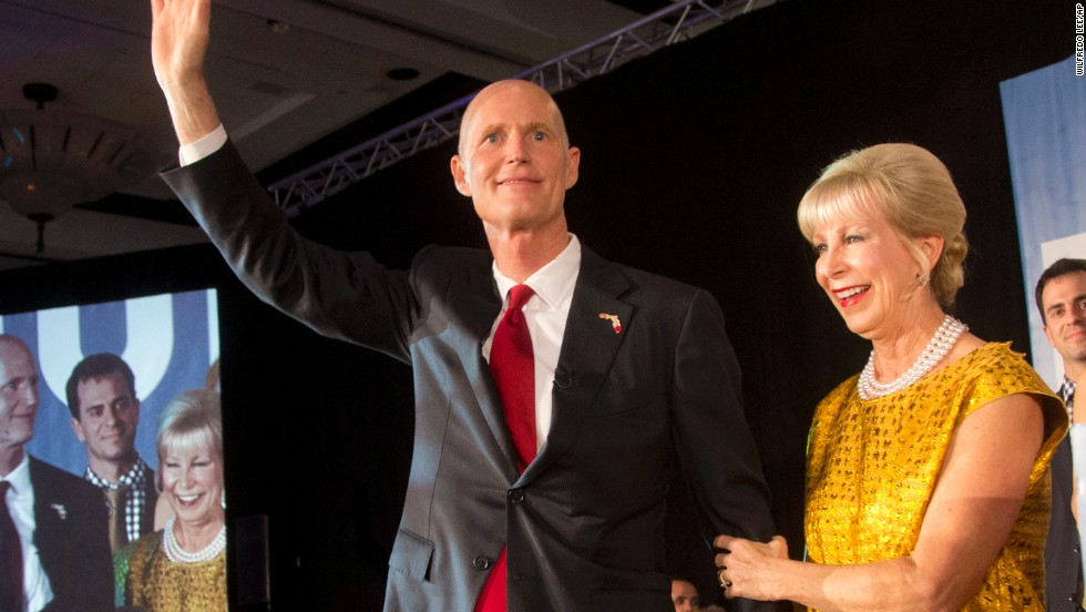 Florida Gov. Rick Scott waves to the crowd as he and his wife, Ann, take the stage at a victory party in Bonita Spring, Florida, after defeating Democratic challenger Charlie Crist on Tuesday, November 4.