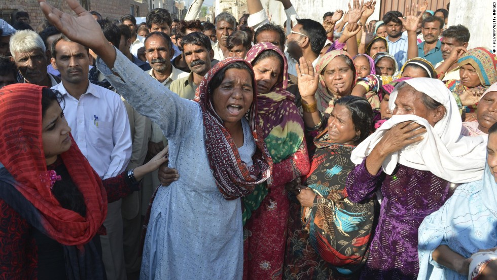 Relatives mourn the death of the couple, who were beaten and thrown into a kiln after allegedly desecrating the Quran in Kot Radha Kishan, Pakistan, November 5.