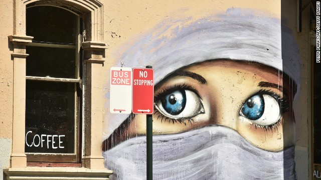 A mural of a Muslim woman in Sydney, where a Shia leader was shot by suspected Sunni extremists Monday.