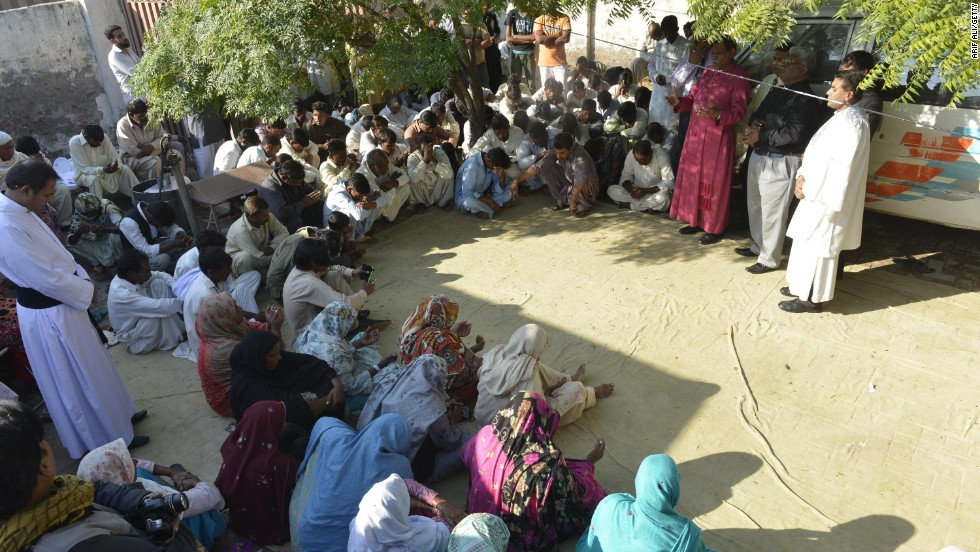 "Christians gather and pray for the couple after an act described as a ""callous murder"" by the Human Rights Commission of Pakistan (HRCP)."