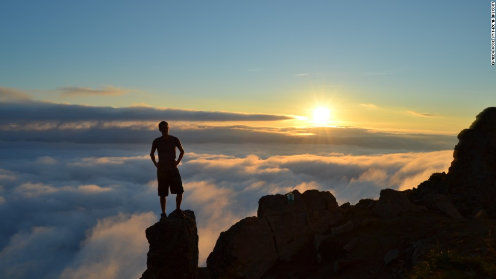 "<a href=""http://ireport.cnn.com/docs/DOC-1015010"">Laneda Rose Smith </a>photographed this stunning image of her friend, Patrick, standing on Flattop Mountain in Anchorage, Alaska, at sunset. ""Being above the clouds while not in an airplane was one of the most remarkable things I have ever witnessed."""