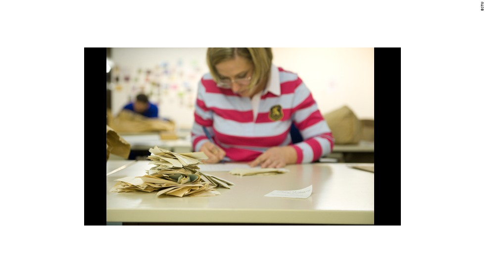 A Stasi Records Agency employee pieces together some of the 600 million fragments of paper.