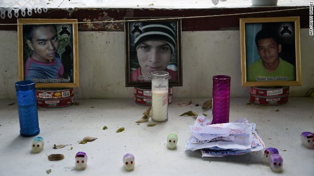 "Portraits of missing students are displayed in an improvised altar at Ayotzinapa school in Tixtla, Guerrero state, Mexico, on November 8, 2014. Suspected gang members in Mexico confessed to killing more than 40 missing students and incinerating their remains in a grisly case that shocked the country and triggered angry protests, authorities said. Facing the biggest crisis of his administration, President Enrique Pena Nieto vowed to hunt down all those responsible for the ""horrible crime."" Authorities have been searching for 43 students since gang-linked police attacked their buses in the southern city of Iguala on September 26, allegedly under orders of the mayor and his wife in violence that left six people dead. AFP PHOTO/RONALDO SCHEMIDTRONALDO SCHEMIDT/AFP/Getty Images"