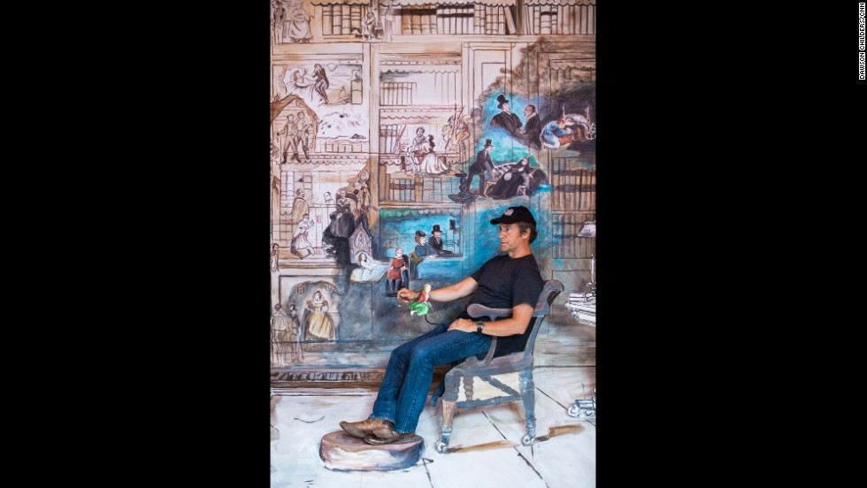 Rowe sits in front of one of the life-sized paintings created for Pageant of the Masters.