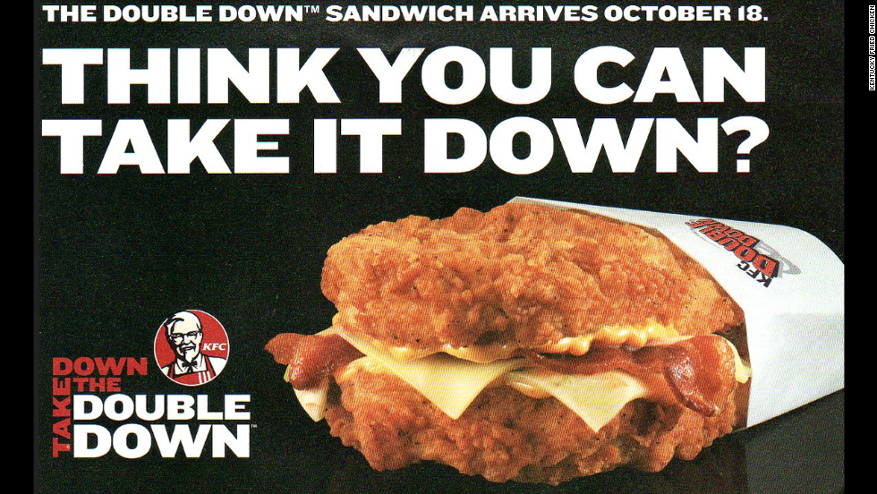 "Craving a hamburger, fried chicken and bacon all at once? KFC's Zinger Double Down<strong> </strong>has you covered. The hamburger topped with bacon, barbecue sauce and ""pepper dressing"" sandwiched between two pieces of crispy fried chicken, um, doubles down on the fast-food chain's success with the original 2010 Double Down, pictured, a sandwich of bacon, cheese and the Colonel's sauce between two chicken fillets."