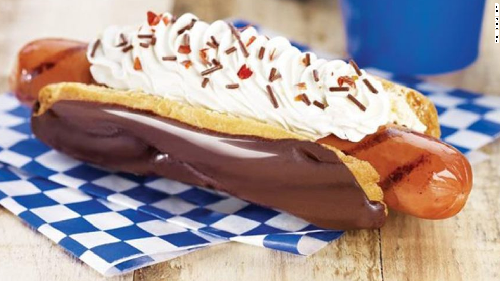 "When you think of traditional Canadian food, what comes to mind? Canadian bacon? Poutine? <a href=""http://www.timhortons.com/us/en/menu/timbits.php"" target=""_blank"">Timbits</a>? Maple Lodge Farms tried to create a new tradition: the hot dog eclair, a delicious tube of processed meat combined with a cream-filled, chocolate-covered pastry. The product debuted at the 2012 Canadian National Exhibition, so it's as purely Canadian as a hockey puck dipped in maple syrup. Hmm, that gives us another idea for a hybrid dish. ..."