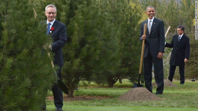 US President Barack Obama (C) takes part in a tree-planting ceremony with Canada's Trade Minister Ed Fast (L) and Mexico's President Enrique Pena Nieto (R) at the Asia-Pacific Economic Cooperation (APEC) economic leaders' meeting outside the International Conference Center in Yanqi Lake, north of Beijing, on November 11, 2014. Top leaders and ministers of the 21-member APEC grouping are meeting in Beijing from November 7 to 11. AFP PHOTO / MANDEL NGAN        (Photo credit should read MANDEL NGAN/AFP/Getty Images)