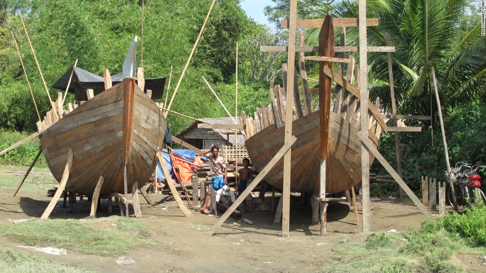 Rohingya fishermen build boats. They say human traffickers use boats like these to illegally transport Rohingya to other countries in search of a better life. Many risk everything to leave Myanmar. Boats this size can carry 50 to 60 people, the builders say.