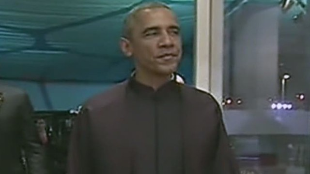 sot nr obama putin china apec gum chewing shawl_00001811.jpg