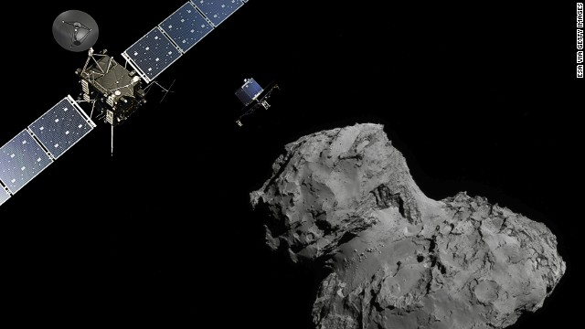 In this November 10, 2014 handout photo illustration provided by the European Space Agency (ESA) the Rosetta probe (L) and Philae lander are pictured above the 67P/Churyumov-Gerasimenko comet. ESA will attempt to land the Philae lander onto the comet in the afternoon (GMT) of November 12 which, if successful, will be the first time ever that a man-made craft has landed onto a comet.
