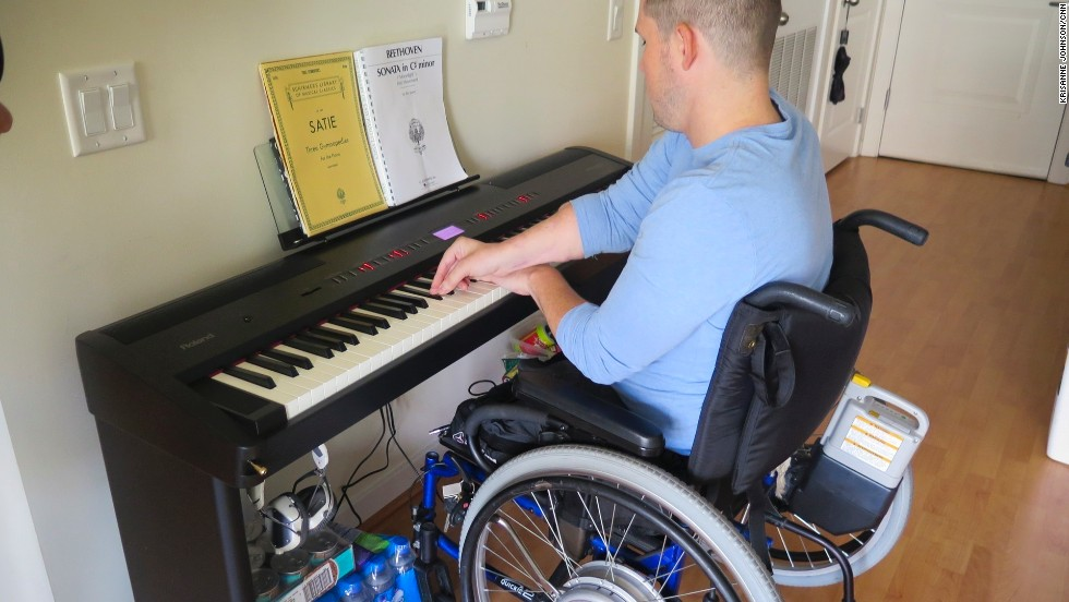 "MusiCorps participant Greg Galeazzi practices at his home in Washington. ""Music has always been important to me,"" he said. ""I felt a deep sadness because I thought I'd lost my ability to play music."""