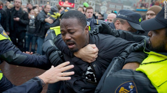 Police detain an anti-Black Pete demonstrator in Gouda, Netherlands, on Saturday.