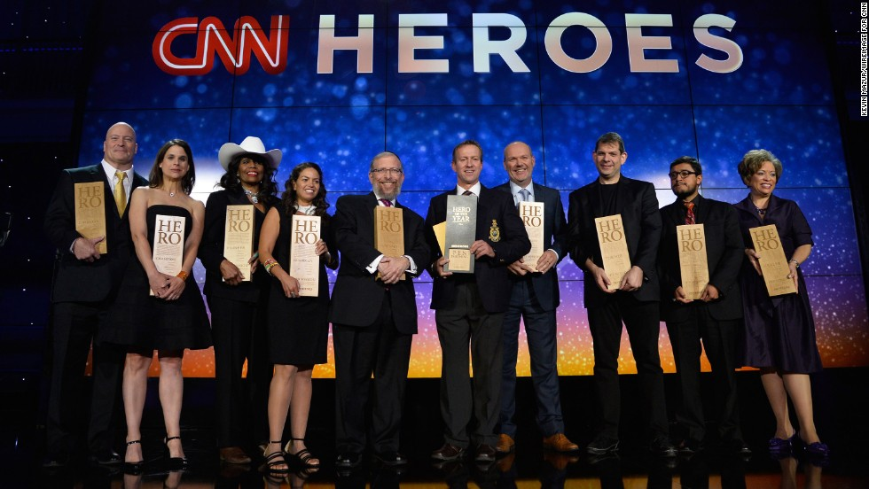 The top 10 CNN Heroes of the year pose on stage with their awards during the annual tribute show in New York.