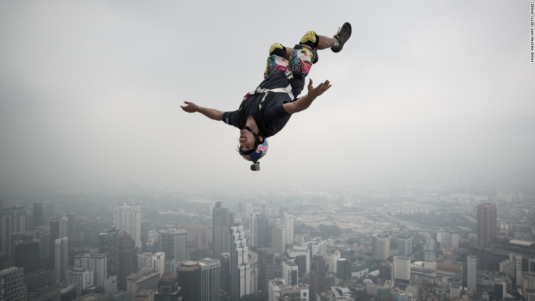 a base jumper leaps from the 980foot open deck of