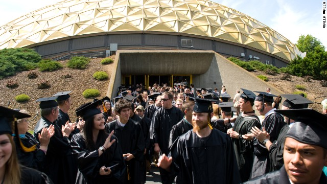 Graduates stream from the WWCC Dietrich Activity Center.