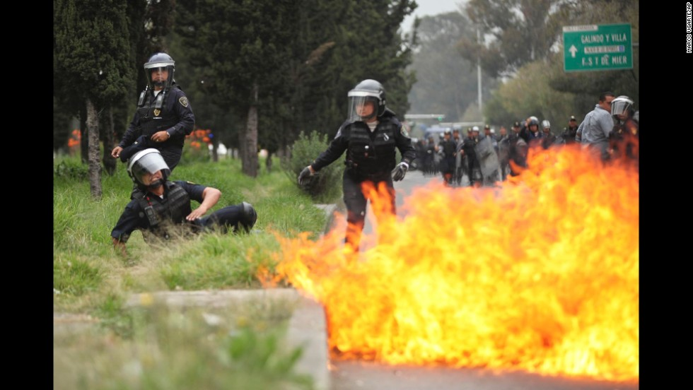 A police officer falls after a protester threw a Molotov cocktail on November 20.