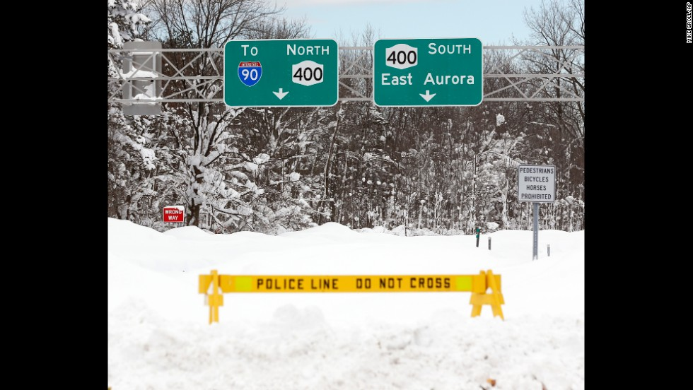 A police barrier prevents vehicles from entering Route 400 in West Seneca, New York, on November 20.