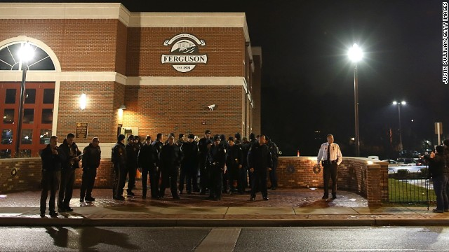 FERGUSON, MO - NOVEMBER 21: Police gather in front of the Ferguson fire station as demonstrators protest the shooting death of 18-year-old Michael Brown on November 21, 2014 in Ferguson, Missouri. Brown, who was black, was killed by Darren Wilson, a white Ferguson, Missouri police officer, on August 9. Tensions remain high as a grand jury is expected to decide soon if Wilson should be charged in the shooting. (Photo by Justin Sullivan/Getty Images)