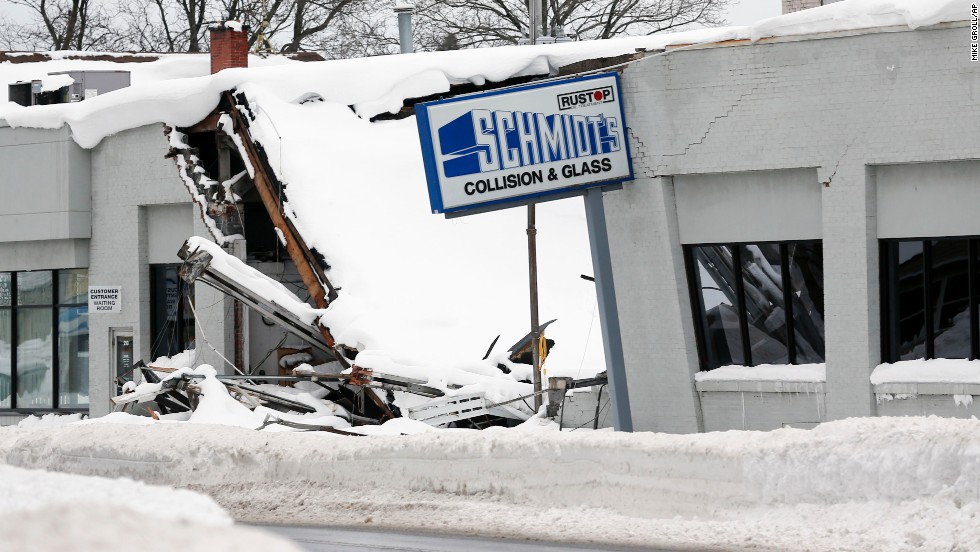 Heavy snow caused the roof of Schmidt's Collision and Glass to collapse in Hamburg, New York, on November 22.
