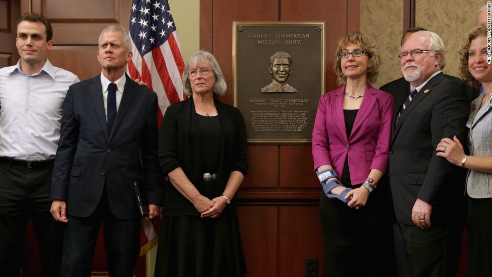 Giffords joins, from left, Ben Zimmerman, Ross Zimmerman, Emily Nottingham, Rep. Ron Barber and Rep. Debbie Wasserman-Schultz during a dedication ceremony on April 16, 2013 for Gabriel Zimmerman, a member of Gifford's staff who was murdered during the January 8 shooting spree.