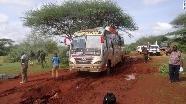 Kenyan security forces and others gather around the scene on an attack on a bus outside the town of Mandera