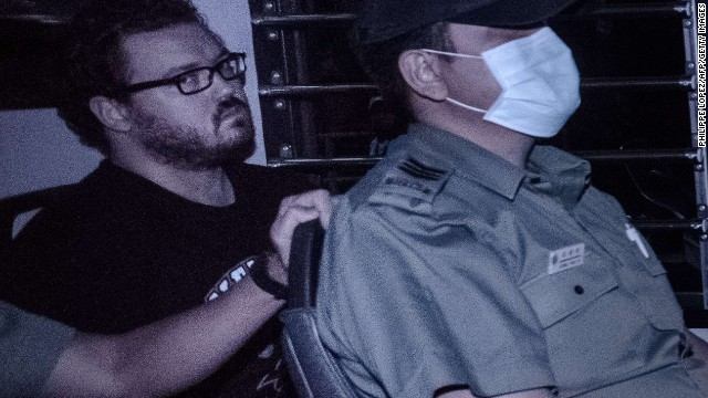 British banker Rurik Jutting, charged with the grisly murders of two women, sits in a prison van as he leaves the eastern court in Hong Kong on November 10, 2014. Jutting had his case adjourned by a Hong Kong court for two weeks of psychiatric reports, as the victims' bodies were due to be flown home to Indonesia. AFP PHOTO / Philippe LopezPHILIPPE LOPEZ/AFP/Getty Images