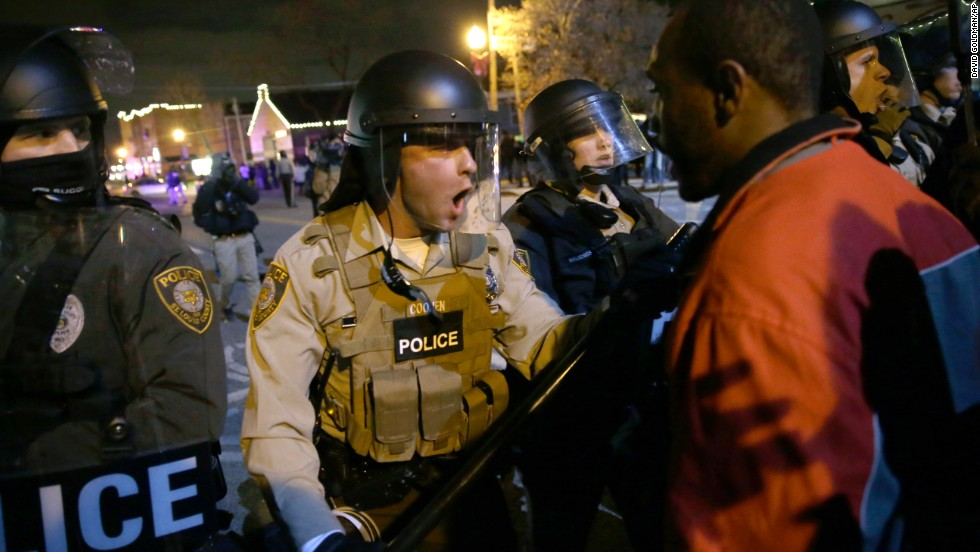 Police officers confront protesters on November 24.