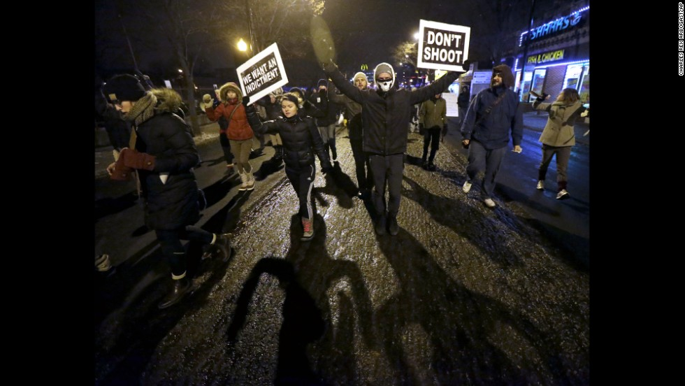 Protesters march near Chicago police headquarters on November 24.