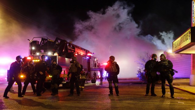 Smoke fills the streets as buildings burn in Ferguson.